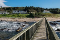 Landscape wooden bridge at Ballycastle beach, Northern Ireland. Ballycastle Beach is a popular tourist destination located on the Causeway Coastal Route on the royalty free stock photography