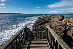 Landscape wooden bridge at Ballycastle beach, Northern Ireland. Ballycastle Beach is a popular tourist destination located on the Causeway Coastal Route on the royalty free stock image