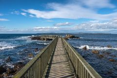 Landscape wooden bridge at Ballycastle beach, Northern Ireland. Ballycastle Beach is a popular tourist destination located on the Causeway Coastal Route on the stock photo