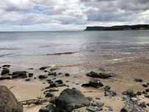 Ballycastle Beach Looking East Towards Fairhead Ireland. Ballycastle beach is a popular tourist destination located on the Causeway Coastal route on the Antrim royalty free stock images