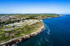 Ballycastle and cliffs, Northern Ireland. Aerial view. Aerial view of Ballycastle with steep cliffs. Atlantic coast, County Antrim, Northern Ireland, UK royalty free stock images