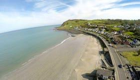 Ballygally Village Co. Antrim Northern Ireland. Thrones irish sea and a tree stock photos