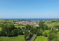 Ballygally Village Co. Antrim Northern Ireland. Thrones irish sea and a tree royalty free stock photo