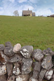 Ballyvaughan old stone wall and church Stock Image