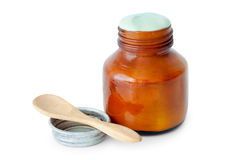 A balm jar full of medicated ointment and spoon. Royalty Free Stock Photos