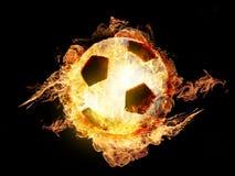 Balón de fútbol en el fuego Fotos de archivo libres de regalías