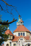 Balneological Department, Sopot. SOPOT, POLAND - JUNE 6: Fragment of historic building of balneology Department and old lighthouse in Sopot, Poland on June 6 Royalty Free Stock Photos