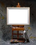 Balnk canvas. Blank painting canvas on large artist easel Royalty Free Stock Photo
