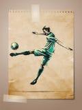 Balompié, bosquejo del jugador de fútbol en la nota envejecida Pape libre illustration