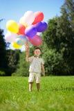 balonów wiązki dziecko wręcza ich Zdjęcie Royalty Free