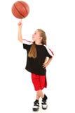 Baloncesto de giro del niño orgulloso de la muchacha en el dedo fotos de archivo