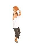 Baloncesto que lanza del muchacho joven Foto de archivo libre de regalías