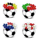 Balones de fútbol con los indicadores nacionales florales Imágenes de archivo libres de regalías