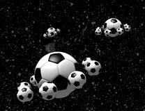 Balones de fútbol en el espacio Fotos de archivo