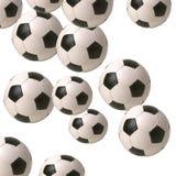 Balones de fútbol que caen Imagen de archivo