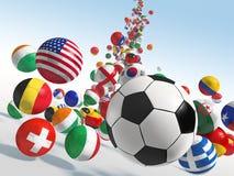 Balones de fútbol que caen Fotos de archivo