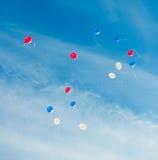 Baloones di colore del giocattolo nel cielo Fotografie Stock