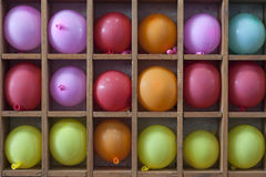 Baloons. Ballonos in different colors on the shelf Royalty Free Stock Photography