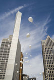 Baloons in the city. White balloons released simultaneously in downtown Detroit Royalty Free Stock Photo