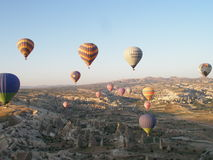 Baloons flying above Capadocia in Turkey. Baloon trips at sunrise above a beautiful part of Turkey - Capadocia Royalty Free Stock Photos