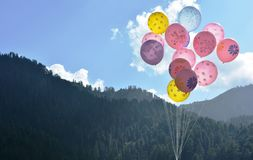 Baloons on hilly valleys royalty free stock photography