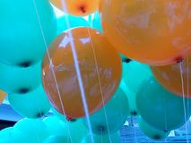 Baloons. Orange and blue baloons Royalty Free Stock Images