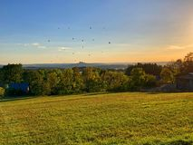 Baloons and sunset. Field with view on baloons at sunset royalty free stock image