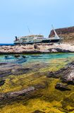 Balos bay and  Passenger Ship. View from Gramvousa Island, Crete in Greece.Magical turquoise waters, lagoons, beaches of pure wh. Balos beach and  Passenger Ship Royalty Free Stock Images