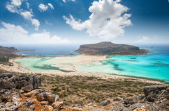 Balos lagoon on Crete island, Greece. Tourists relax and bath in crystal clear water of Balos beach Royalty Free Stock Image
