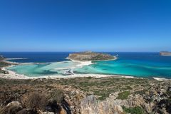 Balos lagoon, a paradise beach with crystal clear water and white sand on Crete island, Greece. Balos lagoon, a paradise and relaxing beach with crystal clear royalty free stock images