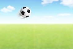 balowego pola latający futbol Zdjęcia Stock