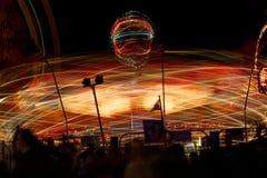 A balsa justa do carnaval roda dentro a velocidade Fotografia de Stock