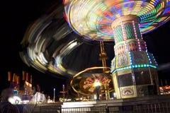 A balsa justa do carnaval roda dentro a velocidade Imagens de Stock Royalty Free