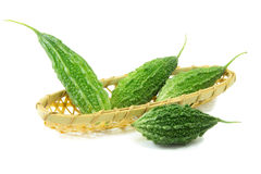 Balsam pear in basket on white background Stock Photos