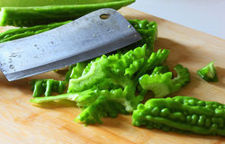 Balsam pear and kitchen knife Stock Photos
