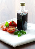Balsamic. Vinegar in bottle with tomato royalty free stock photos