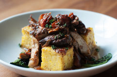 Balsamic Braised Chicken. With vegetables over polenta stock photos