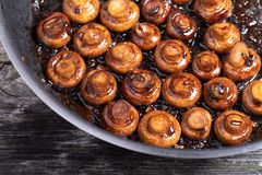 Balsamic garlic musrooms. Close up of fried mushrooms with balsamico and garlic. Perfect side dish stock image