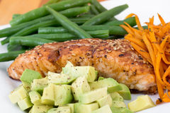 Balsamic and maple salmon. Dish with bean avocado and yam stock images