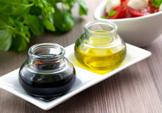 Balsamic and olive oil. Balsamic vinegar and olive oil in two glasses stock photo