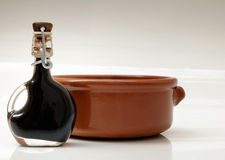 Balsamic vinegar. Of Modena (Italy) and a earthenware bowl Royalty Free Stock Photos