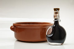 Balsamic vinegar. Of Modena (Italy) and a earthenware bowl Stock Photo