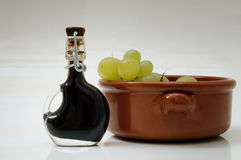 Balsamic vinegar. Of Modena (italy) and a earthenware bowl with grape stock photo