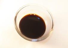 Balsamic vinegar. Black balsamic vinegar, isolated on white background Stock Images