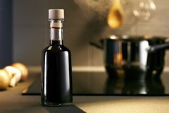 Balsamic vinegar bottle in a kitchen Royalty Free Stock Photo