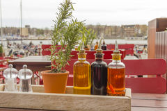 Balsamic vinegar bottles and condiments on the table in an open Royalty Free Stock Photo