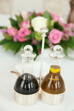 Balsamic vinegar and olive oil on arranged table Stock Photo