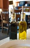 Balsamic Vinegar and Olive Oil on Table Royalty Free Stock Images