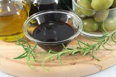 Balsamic vinegar, olives, olive oil Stock Images