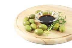 Balsamic vinegar, olives Stock Photography